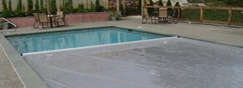 covered rectangular pool with patio
